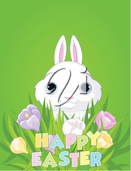A cute Easter bunny sits in the crocus bouquet
