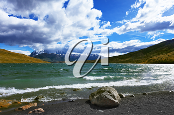 The fantastic lake Lagoon Azul in national park Torres del Paine. In the Chilean Patagonia gale