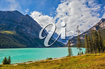 Magnificent Lake Louise is surrounded by mountain and glaciers. Rocky Mountains, Canada, Banff National Park. Great day