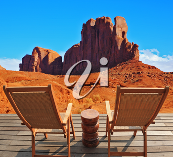Two wooden deck chairs on the platform are to review rock Camel. Red sandstone in the valley of the Navajo, USA