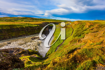 Grand Golden Waterfall on the Hvitau River. The picturesque waterfall in Iceland - Gullfoss. The concept of extreme and phototourism