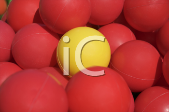 Royalty Free Photo of Red Balls and One Yellow One