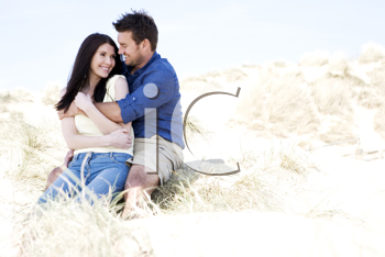 Royalty Free Photo of a Couple Sitting at the Beach