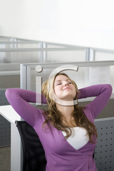 Royalty Free Photo of a Woman Relaxing in an Office Cubicle