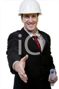 Royalty Free Photo of a Man in a Hardhat Extending His Hand