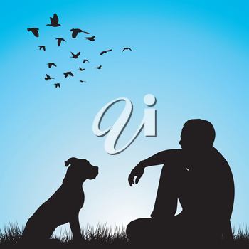 Man and his dog sitting on grass in park