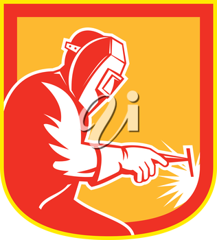 Illustration of welder worker working holding welding torch viewed from side set inside shield crest on isolated background done in retro style.