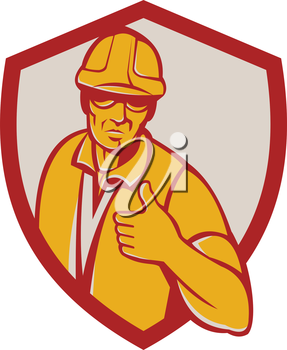 Illustration of a construction worker wearing hardhat thumbs up facing front set inside shield crest done in retro style.