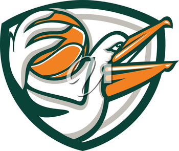 Illustration of a pelican holding dunking basketball viewed from the side set inside shield crest on isolated background done in retro style.