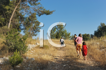 Royalty Free Photo of People Walking on a Country Lane