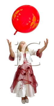 Girl in a smart dress plays with a red balloon.