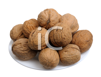 Walnuts  in a white plate on a white background, isolated