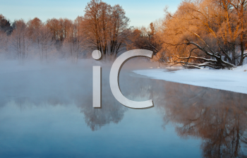 Royalty Free Photo of a Frosty Autumn Morning With Fog Over the Water