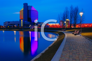 Royalty Free Photo of a City at Night Reflected in the Water