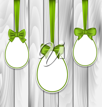 Illustration Easter three papers eggs wrapping green bows on grey wooden background - vector