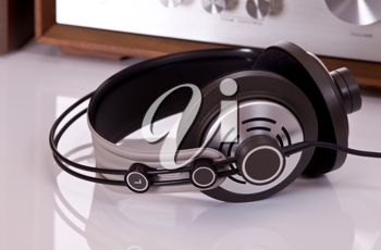 Royalty Free Photo of Headphones Connected to a Stereo