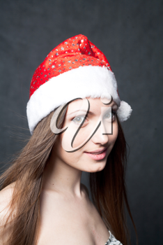 Mrs. Santa dreaming about Chrismas presents isolated on black background