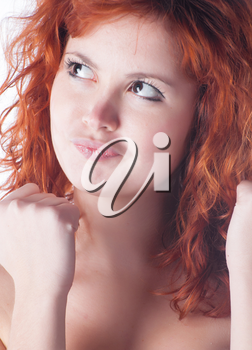 Redhead with fist on white closeup