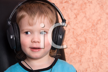 Royalty Free Photo of a Boy Wearing Headphones