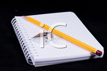 Royalty Free Photo of a Pencil on a Notebook