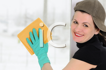 Royalty Free Photo of a Woman Washing a Window