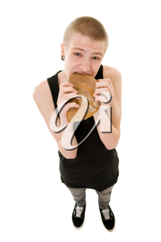 The hungry teenager eating a bread isolated on white background