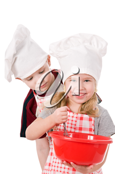 two children in chef's hat isolated on white background