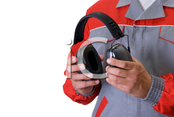Royalty Free Photo of a Man Holding Protective Headphones