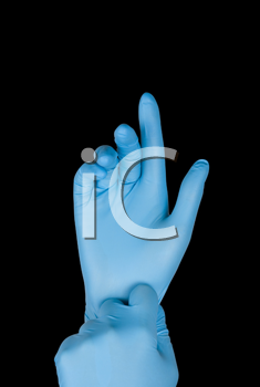 Royalty Free Photo of a Person Wearing Blue Gloves