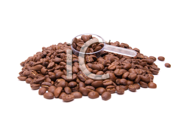 coffee beans with spoon on a white background