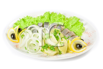 Herring with potato and vegetables isolated on a white background