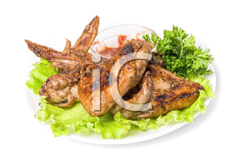 Tasty grilled chicken wings with vegetables and sauce