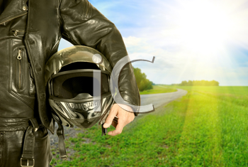 Royalty Free Photo of a Biker Holding a Helmet