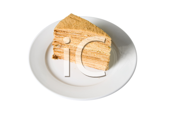 Piece of a pie at plate on white