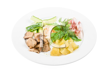Tasty appetizer: potato, fat and vegetables at plate