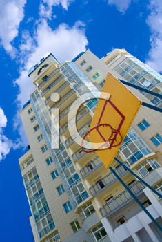 Royalty Free Photo of a Basketball Net in Front of a Building