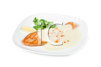 Grilled salmon steak with cheese sauce, greens, lemon and red caviar