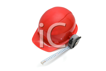 Royalty Free Photo of a Hardhat and Measuring Tape
