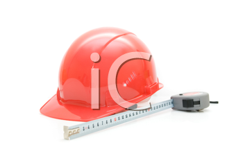 Red Safety helmet and measuring tape isolated on white