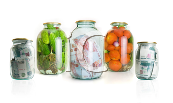Royalty Free Photo of Glass Jars With Cucumbers, Tomatoes and Money in Them