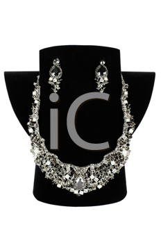 a necklace with pendants and earrings on a white background