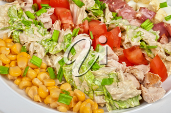 Salad with bacon, chicken, tomato, eggs and corn