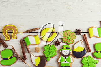 Gingerbreads for Patrick's day and on wooden background