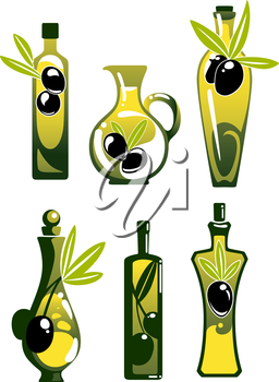 Extra virgin olive oil in glass bottles and jugs, decorated by twigs with black fruits and leaves, for healthy vegetarian food