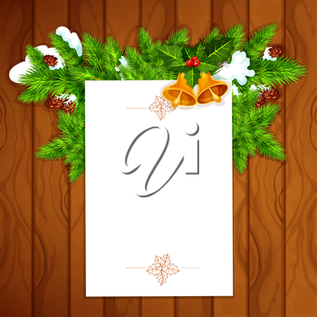 Christmas and New Year greeting card with blank paper, decorated by holly berry with bell and snowy pine branch with cone on wooden background. Xmas card template design with copy space