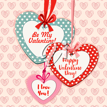 Heart shaped Valentine cards hanging on red and pink ribbons with bows, decorated by polka-dot borders
