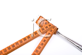 Royalty Free Photo of a Fork and Measuring Tape