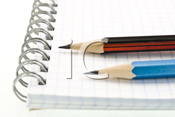 Royalty Free Photo of a Spiral Notepad With Pencils
