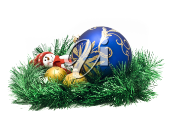 Christmas toy with three colorful New Year decoration Balls and green tinsel over white