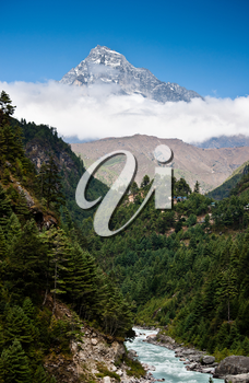 Himalaya mountains Landscape: peak, stream and forest. Travel to Nepal